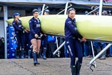 The Cancer Research UK Women's Boat Race 2018: The Oxford women carrying their boat from the boathouse to the river - in focus 4 seat Alice Roberts and 7 Abigail Killen. River Thames between Putney Bridge and Mortlake, London SW15,  United Kingdom, on 24 March 2018 at 15:42, image #93