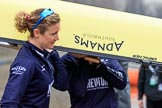 The Cancer Research UK Women's Boat Race 2018: The Oxford women carrying their boat from the boathouse to the river. here 5 seat Morgan McGovern. River Thames between Putney Bridge and Mortlake, London SW15,  United Kingdom, on 24 March 2018 at 15:42, image #94