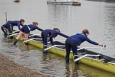 The Cancer Research UK Women's Boat Race 2018: The Oxford Blue Boat crew getting their boat ready for the race, here stroke Beth Bridgman, 7 seat Abigail Killen, 6 Sara Kushma, and 5 Morgan McGovern. River Thames between Putney Bridge and Mortlake, London SW15,  United Kingdom, on 24 March 2018 at 15:43, image #99