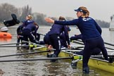 The Cancer Research UK Women's Boat Race 2018: The Oxford Blue Boat crew getting their boat ready for the race, here bow seat Renée Koolschijn throwing one of her wellies to terra firma. River Thames between Putney Bridge and Mortlake, London SW15,  United Kingdom, on 24 March 2018 at 15:44, image #100