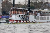 The Cancer Research UK Women's Boat Race 2018: The Cambridge Blue Boat, seconds after the start of the race, passing the Cambridge supporters Thames ship Elizabethan. River Thames between Putney Bridge and Mortlake, London SW15,  United Kingdom, on 24 March 2018 at 16:31, image #166