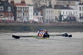 The Cancer Research UK Women's Boat Race 2018: The Cambridge boat is just visible on the left as they extend their lead. In the Bandstand area, here the Oxfford boat with bow Renée Koolschijn, 2 Katherine Erickson, 3 Juliette Perry, 4 Alice Roberts, 5 Morgan McGovern, 6 Sara Kushma, 7 Abigail Killen, stroke Beth Bridgman, cox Jessica Buck. River Thames between Putney Bridge and Mortlake, London SW15,  United Kingdom, on 24 March 2018 at 16:45, image #189
