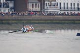 The Cancer Research UK Women's Boat Race 2018: The trailing Oxford boat can just be seen on the right as the Cambridge women extend their lead. Here near the Bandstand, in the Cambridge boat bow Tricia Smith, 2 Imogen Grant, 3 Kelsey Barolak, 4 Thea Zabell, 5 Paula Wesselmann, 6 Alice White, 7 Myriam Goudet-Boukhatmi, stroke Olivia Coffey, cox Sophie Shapter. River Thames between Putney Bridge and Mortlake, London SW15,  United Kingdom, on 24 March 2018 at 16:45, image #190