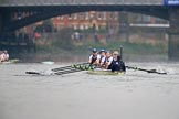 The Cancer Research UK Women's Boat Race 2018: Near Barnes Bridge, the Cambridge boat, just visible on the left, is getting further ahead. In the Oxford boat bow Renée Koolschijn, 2 Katherine Erickson, 3 Juliette Perry, 4 Alice Roberts, 5 Morgan McGovern, 6 Sara Kushma, 7 Abigail Killen, stroke Beth Bridgman, cox Jessica Buck. River Thames between Putney Bridge and Mortlake, London SW15,  United Kingdom, on 24 March 2018 at 16:46, image #192