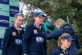 The Cancer Research UK Women's Boat Race 2018: Stepping down from the podium after the race - Oxford' s 3 seat Juliette Perry, 2 Katherine Erickson, and bow Renée Koolschijn. River Thames between Putney Bridge and Mortlake, London SW15,  United Kingdom, on 24 March 2018 at 17:05, image #238