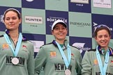 The Cancer Research UK Women's Boat Race 2018: cambridge 4 seat Thea Zabell, 3 Kelsey Barolak, and 2 Imogen Grant on the podium, with their Boat Race medals. River Thames between Putney Bridge and Mortlake, London SW15,  United Kingdom, on 24 March 2018 at 17:07, image #260