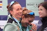 The Cancer Research UK Women's Boat Race 2018: Cambridge stroke Olivia Coffey and 5 sseat Paula Wesselmann, with her Women's Boat Race medals. on the podium. River Thames between Putney Bridge and Mortlake, London SW15,  United Kingdom, on 24 March 2018 at 17:07, image #263
