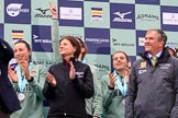 The Cancer Research UK Women's Boat Race 2018: The Women's Boat race presentation - Cambridge stroke Ollivia Coffey, Newton Investment CEO Hanneke Smits, hidden behind her 7 seat Myriam Goudet-Boukhatmi, 6 then Alice White, and Boat Race Company director Fergus Murison. River Thames between Putney Bridge and Mortlake, London SW15,  United Kingdom, on 24 March 2018 at 17:07, image #264