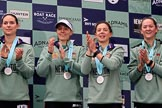 The Cancer Research UK Women's Boat Race 2018: Cambridge  4 seat Thea Zabell, 3 seat Kelsey Barolak, 2 seat Imogen Grant, and  bow seat Tricia Smith, with her Women's Boat Race medals. on the podium. River Thames between Putney Bridge and Mortlake, London SW15,  United Kingdom, on 24 March 2018 at 17:07, image #265