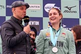 The Cancer Research UK Women's Boat Race 2018: BBC's Sport commentator Jason Mohammad with Cambridge 7 seat Myriam Goudet-Boukhatmi, behind them Cancer Research UK CEO Sir Harpal Kumar. River Thames between Putney Bridge and Mortlake, London SW15,  United Kingdom, on 24 March 2018 at 17:07, image #266