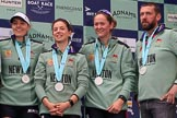 The Cancer Research UK Women's Boat Race 2018: Cambridge  3 seat Kelsey Barolak, 2 seat Imogen Grant, bow seat Tricia Smith, and CUWBC Head Coach Rob Baker with their Women's Boat Race medals. on the podium. River Thames between Putney Bridge and Mortlake, London SW15,  United Kingdom, on 24 March 2018 at 17:08, image #273
