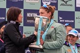 The Cancer Research UK Women's Boat Race 2018: Newton Investment CEO Hanneke Smits handing the Women's Boat Race trophy to Cambridge 7 seat Myriam Goudet-Boukhatmi. River Thames between Putney Bridge and Mortlake, London SW15,  United Kingdom, on 24 March 2018 at 17:09, image #274