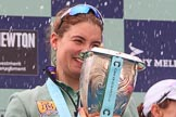 The Cancer Research UK Women's Boat Race 2018: Cambridge 7 seat Myriam Goudet-Boukhatmi with the Women's Boat Race trophy, showered with champagne. River Thames between Putney Bridge and Mortlake, London SW15,  United Kingdom, on 24 March 2018 at 17:09, image #275