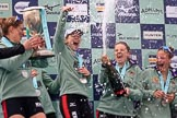 The Cancer Research UK Women's Boat Race 2018: The Cambridge women celebrating with their Boat Race medals, the Women's Boat Race trophy, and lots of Chapel Down Brut: Myriam Goudet-Boukhatmi, Sophie Shapter, Alice White, Paula Wesselmann. River Thames between Putney Bridge and Mortlake, London SW15,  United Kingdom, on 24 March 2018 at 17:09, image #279