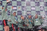 The Cancer Research UK Women's Boat Race 2018: The Cambridge women celebrating with their Boat Race medals, the Women's Boat Race trophy, and lots of Chapel Down Brut.. River Thames between Putney Bridge and Mortlake, London SW15,  United Kingdom, on 24 March 2018 at 17:09, image #282
