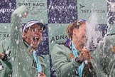 The Cancer Research UK Women's Boat Race 2018: The Cambridge women celebrating with their Boat Race medals, the Women's Boat Race trophy, and lots of Chapel Down Brut.. River Thames between Putney Bridge and Mortlake, London SW15,  United Kingdom, on 24 March 2018 at 17:09, image #281