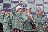 The Cancer Research UK Women's Boat Race 2018: The Cambridge women celebrating with their Boat Race medals, the Women's Boat Race trophy, and lots of Chapel Down Brut.. River Thames between Putney Bridge and Mortlake, London SW15,  United Kingdom, on 24 March 2018 at 17:09, image #280