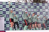 The Cancer Research UK Women's Boat Race 2018: The Cambridge women celebrating with their Boat Race medals, the Women's Boat Race trophy, and lots of Chapel Down Brut. With the trophy Myriam Goudet-Boukhatmi. River Thames between Putney Bridge and Mortlake, London SW15,  United Kingdom, on 24 March 2018 at 17:09, image #283