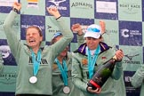 The Cancer Research UK Women's Boat Race 2018: Cambridge victory celebrations and lots of Chapel Down Brut sprayed all over the rowers, here Alice White, Paula Wesselmann, and Sophie Shapter. River Thames between Putney Bridge and Mortlake, London SW15,  United Kingdom, on 24 March 2018 at 17:09, image #285