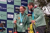 The Cancer Research UK Women's Boat Race 2018: Cambridge bow Tricia Smith, CUWBC Head Coach Rob Baker, Boat Race medals, and bottles of Chapel Down Brut. River Thames between Putney Bridge and Mortlake, London SW15,  United Kingdom, on 24 March 2018 at 17:09, image #287