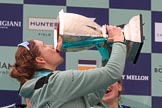 The Cancer Research UK Women's Boat Race 2018: Cambridge 7 seat Myriam Goudet-Boukhatmi drinking champagne out of the Women's Boat Race trophy. River Thames between Putney Bridge and Mortlake, London SW15,  United Kingdom, on 24 March 2018 at 17:09, image #291