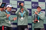 The Cancer Research UK Women's Boat Race 2018: The Cambridge women celebrating with their Boat Race medals, the Women's Boat Race trophy, and lots of Chapel Down Brut: Sophi Shapter,  Thea Zabell, Kelsey Barolak,. River Thames between Putney Bridge and Mortlake, London SW15,  United Kingdom, on 24 March 2018 at 17:09, image #292