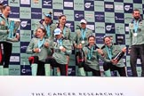 The Cancer Research UK Women's Boat Race 2018: The Cambridge women celebrating with their Boat Race medals, the Women's Boat Race trophy, and lots of Chapel Down Brut: Olivia Coffey  (with the trophy). Paula Wesselmann,  Thea Zabell, Kelsey Barolak, CUWBC Head Coach Rob Baker, and, on their knees, Alice White, Sophie Shapter, Imogen Grant, and Tricia Smith. River Thames between Putney Bridge and Mortlake, London SW15,  United Kingdom, on 24 March 2018 at 17:09, image #295