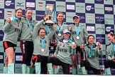 The Cancer Research UK Women's Boat Race 2018: The Cambridge women on the podium, with the Women's Boat Race trophy, their medals, and lots of Castle Down Brut: Myriam Goudet-Boukhatmi, Olivia Coffey, Alice White, Paula Wesselmann, The Zabell, Sophie Shapter, Kelsey Barolak , Imogen Grant, and Tricia Smith. River Thames between Putney Bridge and Mortlake, London SW15,  United Kingdom, on 24 March 2018 at 17:09, image #299