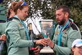 The Cancer Research UK Women's Boat Race 2018: Cambridge 6 seat Alice White with the Women's Boat Race trophy, a bottle of Chapel Down Brut, and Cambridge Head Coach Rob Baker. River Thames between Putney Bridge and Mortlake, London SW15,  United Kingdom, on 24 March 2018 at 17:10, image #305