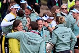 The Cancer Research UK Women's Boat Race 2018: CUWBC Head Coach Rob Baker, with the Women's Boat Race trophy, hugging Maria  O'Connor, Head of Sports Marketing, Professional Sports Group. River Thames between Putney Bridge and Mortlake, London SW15,  United Kingdom, on 24 March 2018 at 17:12, image #311