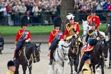 "Trooping the Colour 2010: Three Royal Colonels following Her Majesty during the ""inspection of the line"".  To the left, Charles, The Prince of Wales, Colonel of the Welsh Guards, in the middle Prince Edward, Duke of Kent, Colonel of the Scots Guards, and, on the right, Anne, The Princess Royal, Colonel of the Blues and Royals.  Behind them Lord Vestey, the ""Master of the Horse"".  In the background spectators watching from St. James's Park at the western side of the parade ground, and in the foreground on of the Drum Majors.. Horse Guards Parade, Westminster, London SW1, Greater London, United Kingdom, on 12 June 2010 at 11:06, image #93"