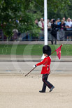 Trooping the Colour 2010: 'March On' - the run-up to the parade. A guardsman of the Grenadier Guards' ('marker') bearing a 'marker flag' that will be used to mark the position of his company on the parade ground. Image #6, 12 June 2010 10:18 Horse Guards Parade, London, UK