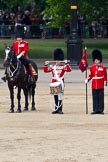 The Colonel's Review 2011: From left to right: Major B P N Ramsay, Welsh Guards, The Major of the Parade, then the 'Lone Drummer', Lance Corporal Gordon Prescott, Scots Guards, and the 'Keeper of the Ground' of No. 1 Guard, 1st Battalion Scots Guards. The Lone Drummer, here saluting, is about to leave the line, marching forward.. Horse Guards Parade, Westminster, London SW1,  United Kingdom, on 04 June 2011 at 11:14, image #119