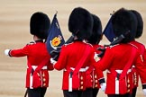 The Major General's Review 2011: The 'Keepers of the Ground', guardsmen of the participating guards divisions, marching towards their position on the parade ground. The flag of the 1st Battalion Scots Guards says 'En Ferus Hostis' - 'Behold A Fierce Enemy'.. Horse Guards Parade, Westminster, London SW1, Greater London, United Kingdom, on 28 May 2011 at 10:17, image #23