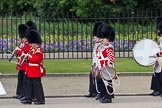 "The Major General's Review 2011: The rear of the Band of the Coldstream Guards, who play Charles Ancliffe's ""The Liberators"" and the Corps of Drums of the 1st Bn Coldstream Guards, march along the West side of the Parade ground to take post in front of the Downing Street garden wall.. Horse Guards Parade, Westminster, London SW1, Greater London, United Kingdom, on 28 May 2011 at 10:25, image #36"