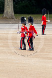 The Major General's Review 2011: The Subalterns, having marched their guards from Wellington Barracks to Horse Guards Parade, now march towards Horse Guards Arch. Here a Lieutenant from No. 7 Company, Coldstream Guards, in front, behind a Captain from 1st Battalion Welsh Guards. Image #48, 28 May 2011 10:29 Horse Guards Parade, London, UK