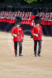 The Major General's Review 2011: The Subalterns, having marched their guards from Wellington Barracks to Horse Guards Parade, now march towards Horse Guards Arch. Here a Lieutenant from No. 7 Company, Coldstream Guards, in front, behind a Captain from 1st Battalion Welsh Guards. Image #49, 28 May 2011 10:30 Horse Guards Parade, London, UK