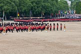 Trooping the Colour 2011: The March Past. On the left, the Massed Bands playing, marching, on the right of the photo, the guards divisions. On Top, No. 1 Guards, the Escort to the Colour, carrying the Colour.