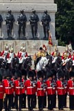 Trooping the Colour 2011: The Household Cavalry in front of the Guards Memorial. On the left, The Life Guards, with the white plumes, in the middle the Trumpeter, Standard Bearer, and Standard Coverer. In front of them No. 2 Guard, B Company Scots Guards.. Horse Guards Parade, Westminster, London SW1, Greater London, United Kingdom, on 11 June 2011 at 12:01, image #375