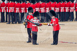 Trooping the Colour 2011: The Sergeant of the Ecort to the Colour, Colour Sergeant Chris Millin, is lowering the Colour, so that the colour case can be removed by the Duty Drummer. Image #54, 11 June 2011 10:33 Horse Guards Parade, London, UK