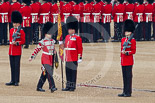 Trooping the Colour 2011: The Colour Party, protetcing the Colour: Holding the Colour - Colour Sergeat Chris Millin, to his left and right the Sentries, Guardsmen Christopher Weavers and Thomas (?), with the Duty Drummer, holding the colour case, marching off. Image #58, 11 June 2011 10:33 Horse Guards Parade, London, UK