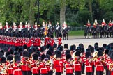 The Colonel's Review 2012: No. 1 Guard (Escort for the Colour), 1st Battalion Coldstream Guards, during the March Past, with the Mounted Bands of the Household Cavalry in the background, and the Massed Bands in the foreground - in the centre the Senior Director of Music, Lieutenant Colonel S C Barnwell, Welsh Guards.. Horse Guards Parade, Westminster, London SW1,  United Kingdom, on 09 June 2012 at 11:46, image #347