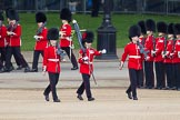 Trooping the Colour 2012: Colour Sereant Paul Baines, carrying the Colour, with the two sentries, guardsmen Gareth Effrington and Kyle Dunbarth. Paul Baines is wearing the Military Cross he received for bravery whilst serving in Afghanistan.. Horse Guards Parade, Westminster, London SW1,  United Kingdom, on 16 June 2012 at 10:30, image #70