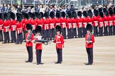 Trooping the Colour 2012: The uncasing the of Colour. With Colour Sergeant Paul Baines MC holding the flag, the Duty Drummer starts removing the colour case.. Horse Guards Parade, Westminster, London SW1,  United Kingdom, on 16 June 2012 at 10:32, image #78
