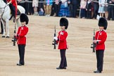 Trooping the Colour 2012: The Colour Party, the Colour Sergeant and the two Sentries, now without the Colour, presenting arms.. Horse Guards Parade, Westminster, London SW1,  United Kingdom, on 16 June 2012 at 11:22, image #315