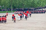 Trooping the Colour 2012: The March Off. The Massed Bands are followed by the Royal Procession, behind them the guardsmen, led by the Ensign, 2nd Lieutenant Hugo Codrington, carrying the Colour, on the left of the image.. Horse Guards Parade, Westminster, London SW1,  United Kingdom, on 16 June 2012 at 12:12, image #679