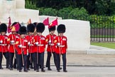 The Colonel's Review 2013: The 'Keepers of the Ground', guardsmen bearing marker flags for their respective regiments, turning towards Horse Guards Parade at the Guards Memorial.. Horse Guards Parade, Westminster, London SW1,  United Kingdom, on 08 June 2013 at 09:53, image #24