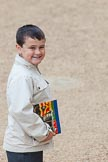 Major General's Review 2013: A young male spectator arriving at Horse Guards Parade for the Major General's Review, proudly carrying the official programme.. Horse Guards Parade, Westminster, London SW1,  United Kingdom, on 01 June 2013 at 09:31, image #9