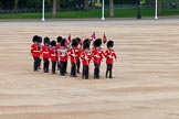 Major General's Review 2013: The 'Keepers of the Ground', guardsmen bearing marker flags for their respective regiments, turning towards Horse Guards Parade at the Guards Memorial.. Horse Guards Parade, Westminster, London SW1,  United Kingdom, on 01 June 2013 at 09:54, image #19