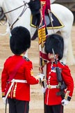 Major General's Review 2013: No. 1 Guard the Regimental Sergeant Major, WO1 Martin Topps, Welsh Guards saluting the Colour with his sword.. Horse Guards Parade, Westminster, London SW1,  United Kingdom, on 01 June 2013 at 11:18, image #392